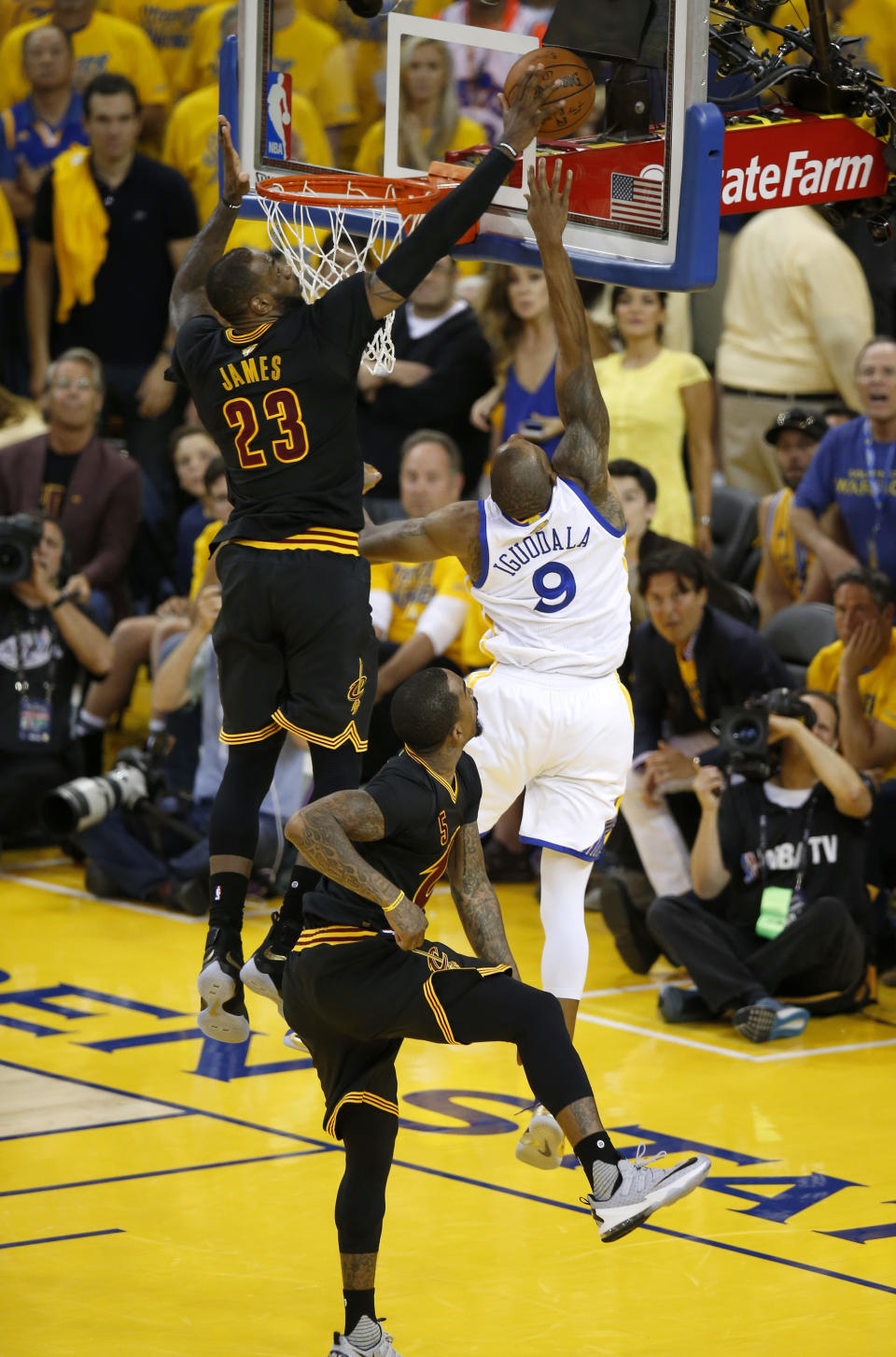 Cleveland Cavaliers' LeBron James (23) blocks a shot against Golden State Warriors' Andre Iguodala (9) in the fourth quarter of Game 7 of the NBA Finals at Oracle Arena in Oakland, Calif., on Sunday, June 19, 2016. (Nhat V. Meyer/Bay Area News Group) (Photo by MediaNews Group/Bay Area News via Getty Images)