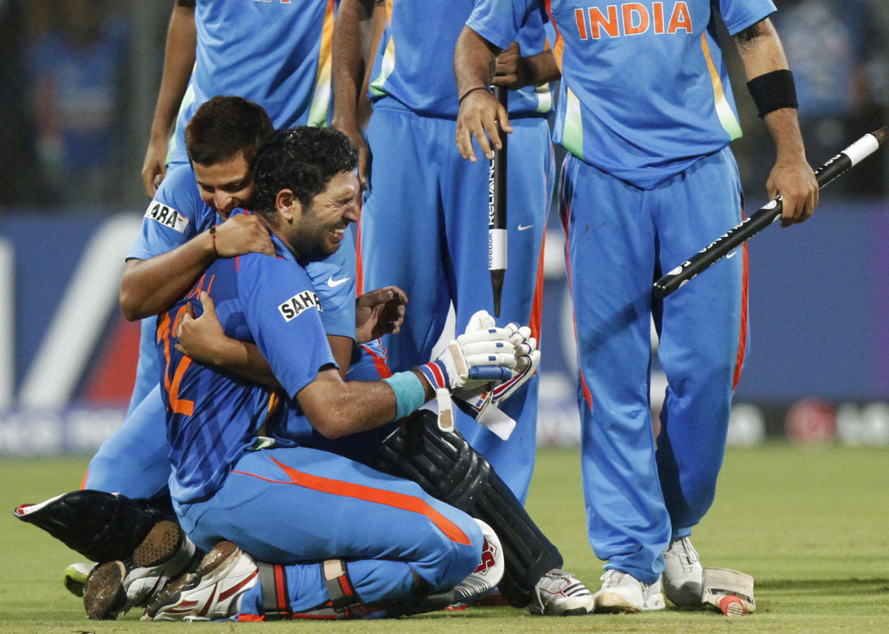 India's Yuvraj Singh, left, is emotional as he is embraced by teammate Suresh Rainai after winning the Cricket World Cup final match between Sri Lanka and India in Mumbai, India, Saturday, April 2, 2011.