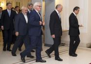 Britain's Foreign Secretary Philip Hammond, Iranian Foreign Minister Mohammad Javad Zarif, US Secretary of State John Kerry, German Foreign Minister Frank-Walter Steinmeier, French Foreign Minister Laurent Fabius and Chinese Foreign Minister Wang Yi arrive for a family picture during their meeting in Vienna November 24, 2014. Iran, the United States and other world powers are all but certain to miss Monday's deadline for negotiations to resolve a 12-year stand-off over Tehran's atomic ambitions, forcing them to seek an extension, sources say. The talks in Vienna could lead to a transformation of the Middle East, open the door to ending economic sanctions on Iran and start to bring a nation of 76 million people in from the cold after decades of hostility with the West. REUTERS/Joe Klamar/Pool (AUSTRIA - Tags: POLITICS ENERGY)