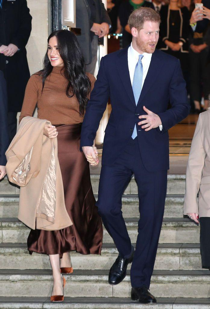 """<p>Harry, 35, and Meghan stop at the Canada House in London to thank the High Commissioner for the warm hospitality the couple received while staying in Canada over the holidays. The appearance comes just one day before making the public announcement that they are <a href=""""https://www.cosmopolitan.com/entertainment/celebs/a30496404/meghan-markle-prince-harry-quitting-royal-family-timeline/"""" rel=""""nofollow noopener"""" target=""""_blank"""" data-ylk=""""slk:leaving the Royal family"""" class=""""link rapid-noclick-resp"""">leaving the Royal family</a>.</p>"""