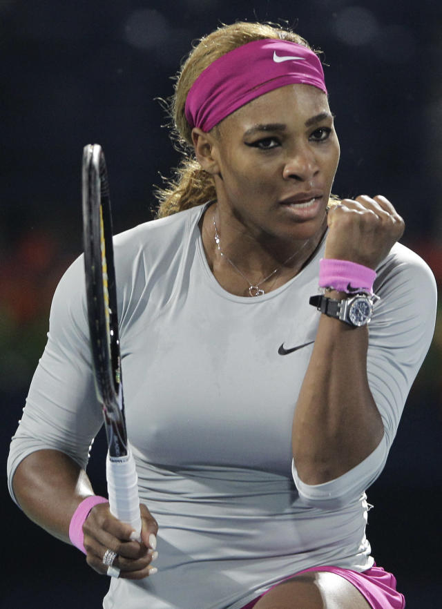 Serena Williams of the U.S. clenches a fist in a match against Jelena Jankovic of Serbia during the quarterfinals of the Dubai Duty Free Tennis Championships in Dubai, United Arab Emirates, Thursday, Feb. 20, 2014. (AP Photo/Kamran Jebreili)