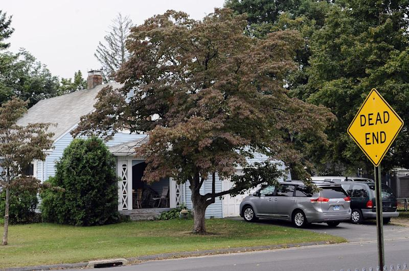 A house owned by the uncle of former New England Patriot's Aaron Hernandez, is seen, Thursday, Sept. 12, 2013 in Bristol, Conn. A group of people who all have ties to a small blue cape-style home in Bristol have become central figures in the investigations linking former New England Patriot Aaron Hernandez to two murder cases. (AP Photo/Jessica Hill)