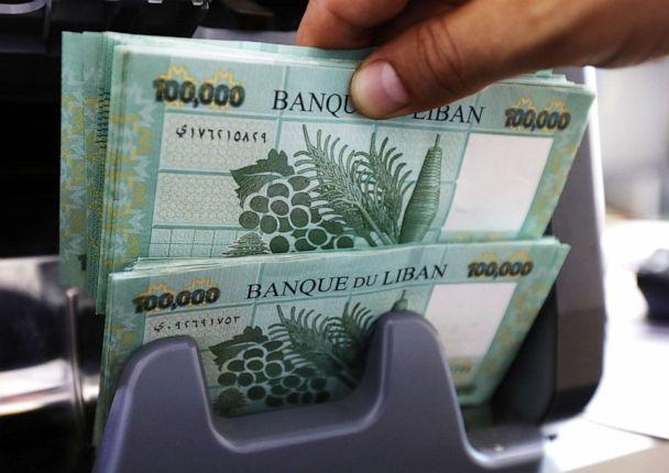 PHOTO: Lebanese pound banknotes are seen at a currency exchange shop in Beirut, Lebanon June 15, 2020. (Mohamed Azakir/Reuters)