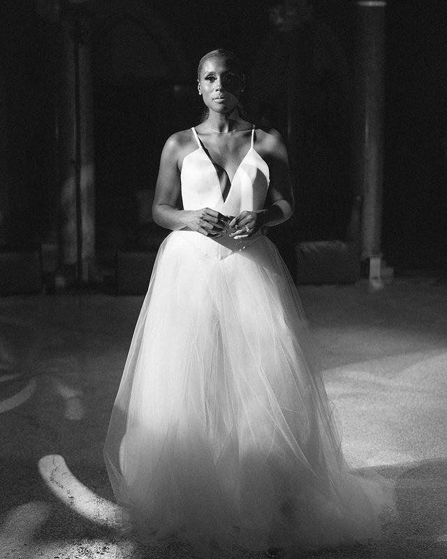 """<p>For the evening reception, Rae changed into another custom Vera Wang design, this time featuring spaghetti straps, a plunging crepe top and layered tulle skirt. </p><p>Vera Wang has been busy of late designing wedding dresses for celebrity clientele. Just two months ago, <a href=""""https://www.elle.com/uk/life-and-culture/culture/a33007446/vera-wang-ageing-fans-shock/"""" rel=""""nofollow noopener"""" target=""""_blank"""" data-ylk=""""slk:the 71-year-old designer"""" class=""""link rapid-noclick-resp"""">the 71-year-old designer</a> also created<a href=""""https://www.elle.com/uk/life-and-culture/wedding/a36456759/ariana-grande-wedding-dalton-gomez/"""" rel=""""nofollow noopener"""" target=""""_blank"""" data-ylk=""""slk:Ariana Grande's wedding dress for her nuptials to Dalton Gomez."""" class=""""link rapid-noclick-resp""""> Ariana Grande's wedding dress for her nuptials to Dalton Gomez.</a></p><p><a href=""""https://www.instagram.com/p/CRyvrYBAsEv/"""" rel=""""nofollow noopener"""" target=""""_blank"""" data-ylk=""""slk:See the original post on Instagram"""" class=""""link rapid-noclick-resp"""">See the original post on Instagram</a></p>"""