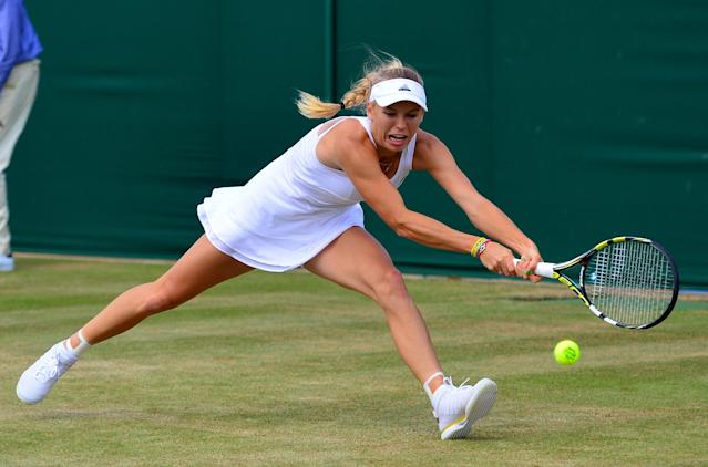Denmark's Caroline Wozniacki returns to Czech Republic's Barbora Zahlavova Strycova during their women's singles fourth round match on day seven of the 2014 Wimbledon Championships, on June 30, 2014 (AFP Photo/Carl Court)