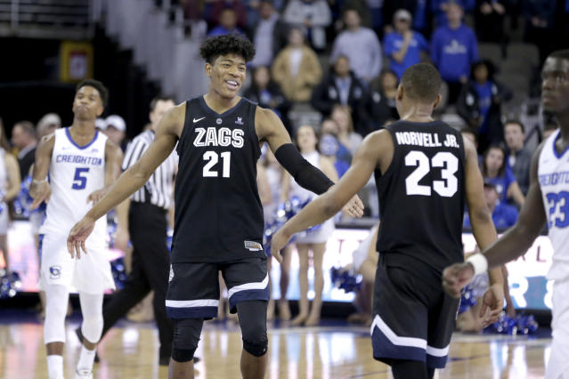 Creighton's Ty-ShonAlexander (5) walks on the court as Gonzaga's Rui Hachimura (21) celebrates with Zach Norvell Jr. (23) their 103-92 win over Creighton in an NCAA college basketball game in Omaha, Neb., Saturday, Dec. 1, 2018. (AP Photo/Nati Harnik)