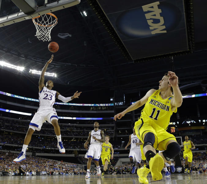 Kansas' Ben McLemore shoots over Michigan's Nik Stauskas during the first half of a regional semifinal game in the NCAA college basketball tournament, Friday, March 29, 2013, in Arlington, Texas. (AP Photo/David J. Phillip)