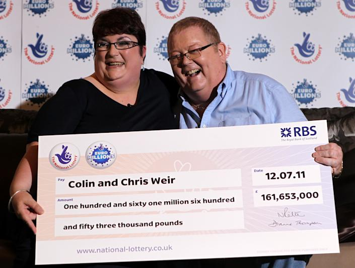 Colin and Chris Weir, from Largs in Ayrshire, pose for photographs during a press conference at the Macdonald Inchyra Hotel & Spa in Falkirk, after they scooped £161 million in Tuesday's EuroMillions draw.