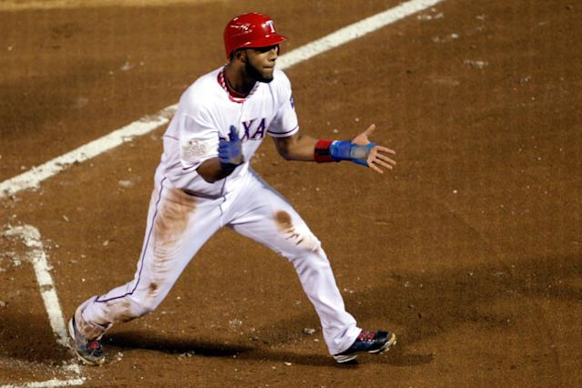 ARLINGTON, TX - OCTOBER 23: Elvis Andrus #1 of the Texas Rangers celebrates after scoring in the first inning during Game Four of the MLB World Series against the St. Louis Cardinals at Rangers Ballpark in Arlington on October 23, 2011 in Arlington, Texas. (Photo by Rob Carr/Getty Images)