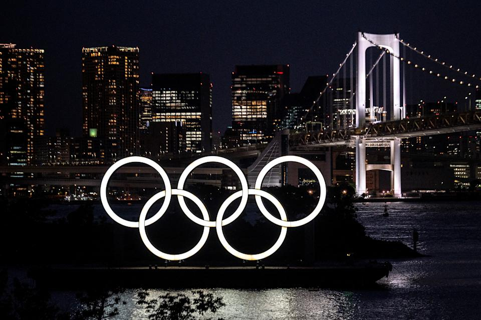 A general view shows the Olympic rings lit up at dusk on the Odaiba waterfront in Tokyo on May 31, 2021. (Photo by Charly TRIBALLEAU / AFP) (Photo by CHARLY TRIBALLEAU/AFP via Getty Images)