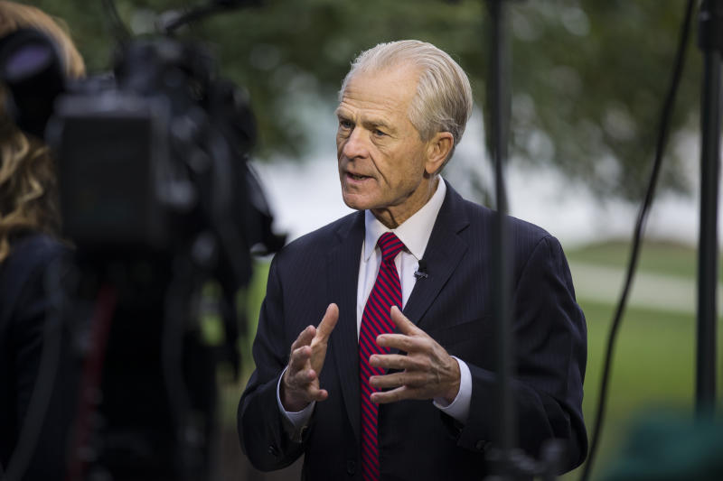 White House trade adviser Peter Navarro speaks during a television interview at the White House, Tuesday, Oct. 8, 2019, in Washington. (AP Photo/Alex Brandon)