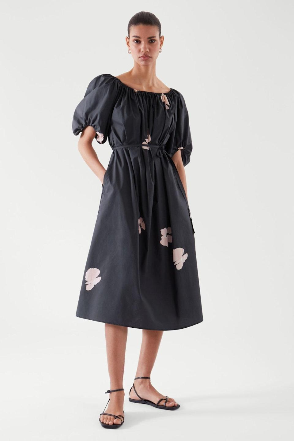 """Revel in the endless versatility of this belted midi, which you can gracefully adjust to accommodate a mini food baby. The dessert bar is calling… $109, Cos. <a href=""""https://www.cosstores.com/en_usd/women/womenswear/dresses/product.puff-sleeve-dress-black.1016405001.html"""" rel=""""nofollow noopener"""" target=""""_blank"""" data-ylk=""""slk:Get it now!"""" class=""""link rapid-noclick-resp"""">Get it now!</a>"""