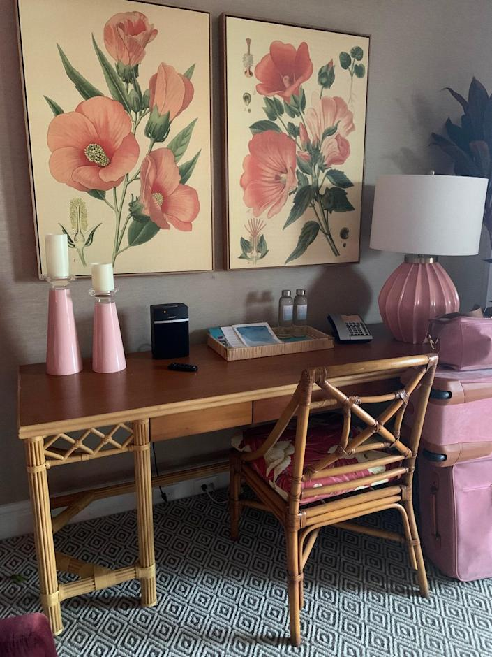 Framed pink hibiscus botanicals enhance the neutral palette of the Hibiscus Suite's wallpaper.