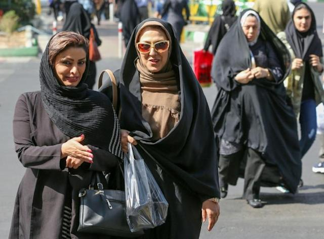 Iranian women are set to freely enter a football stadium for the first time on October 10 as Iran hosts Cambodia in a World Cup 2022 qualifier at Tehran's Azadi stadium (AFP Photo/ATTA KENARE)