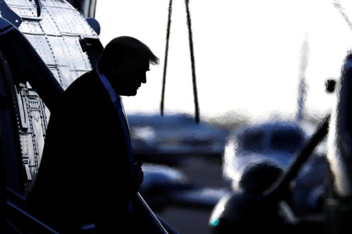 FILE PHOTO: U.S. President Donald Trump descends from Marine One at Miami Executive Airport in Miami, Florida ahead of an evangelical speaking event