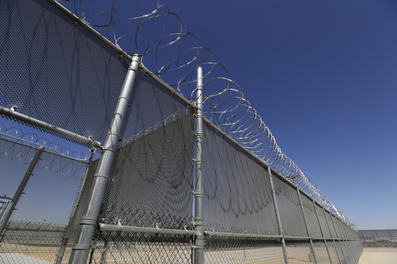 This Wednesday, Aug. 28, 2019, photo shows the Adelanto U.S. Immigration and Enforcement Processing Center operated by GEO Group, Inc. (GEO) a Florida-based company specializing in privatized corrections in Adelanto, Calif. California is banning the use of for-profit, private detention facilities, including those the federal government uses for immigrants awaiting deportation hearings. California Gov. Gavin Newsom announced Friday, Oct. 11, 2019 he had signed a measure into law that helps fulfill his promise to end the use of private prisons.(AP Photo/Chris Carlson)
