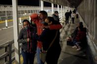 Ortega cries whilst meeting with his family after being deported from U.S. to Mexico in Ciudad Juarez