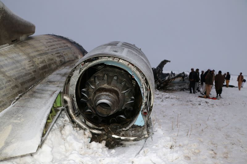 The wreckage of an airplane is seen after a crash in Deh Yak district of Ghazni province, Afghanistan