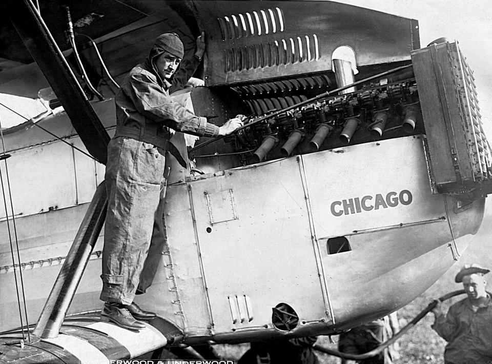 Lt. Lowell H. Smith checks the engine of the Douglas World Cruiser Number 2