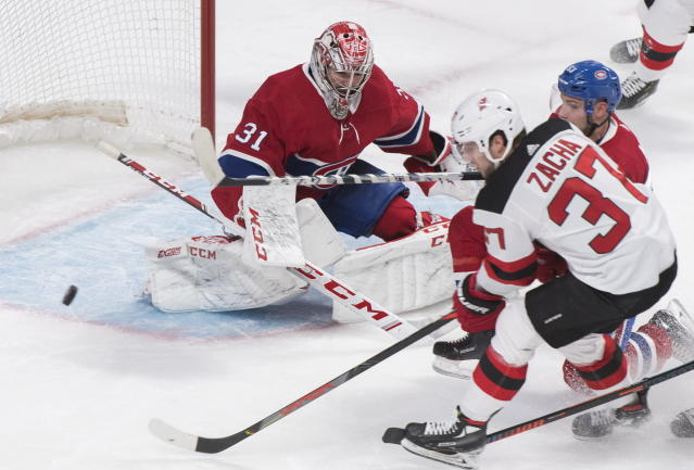 New Jersey Devils' Pavel Zacha (37) moves in on Montreal Canadiens goaltender Carey Price as Canadiens' Victor Mete (53) defends during second-period NHL hockey game action in Montreal, Thursday, Nov. 28, 2019. (Graham Hughes/The Canadian Press via AP)