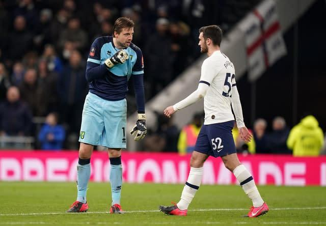 Tim Krul, left, admitted to playing with Troy Parrott's mind ahead of his penalty (John Walton/PA)