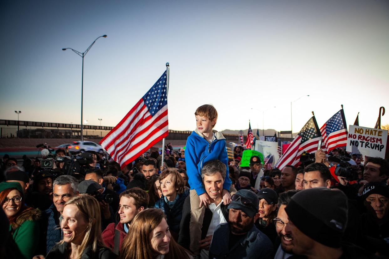 Beto O'Rourke carries his son Henry, 8, in El Paso, Texas, on a march Feb. 11, 2019, along the U.S. border with Mexico to protest President Trump's call for a wall. (Photo: Christ Chavez/Getty Images)
