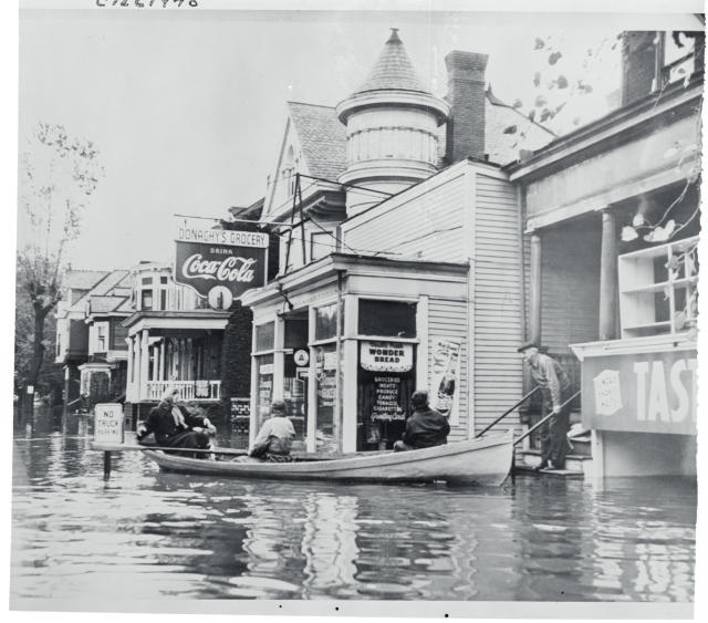 <p>Residents of Wheeling Island are shown as they were evacuated from their homes as flood waters of the Ohio River surged through Wheeling and the Upper Ohio River Valley in West Virginia in October, 1954. The river, which was fed by rain storms in the wake of Hurricane Hazel, caused thousands of people to flee their homes. Damage was estimated in the millions. (Photo from Getty Images) </p>