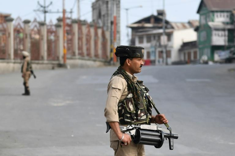 Troops have enforced a strict curfew and are allowing only limited movement on streets usually bustling with tourists flocking to the picturesque valley (AFP Photo/Sajjad HUSSAIN)