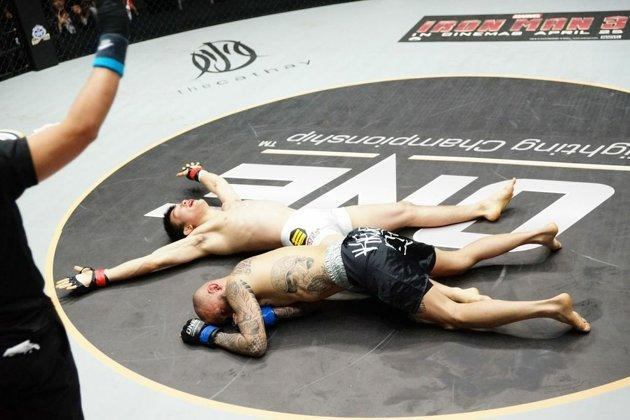 Shinya, arms outstretched in his moment of victory. (Photo: ONE FC)