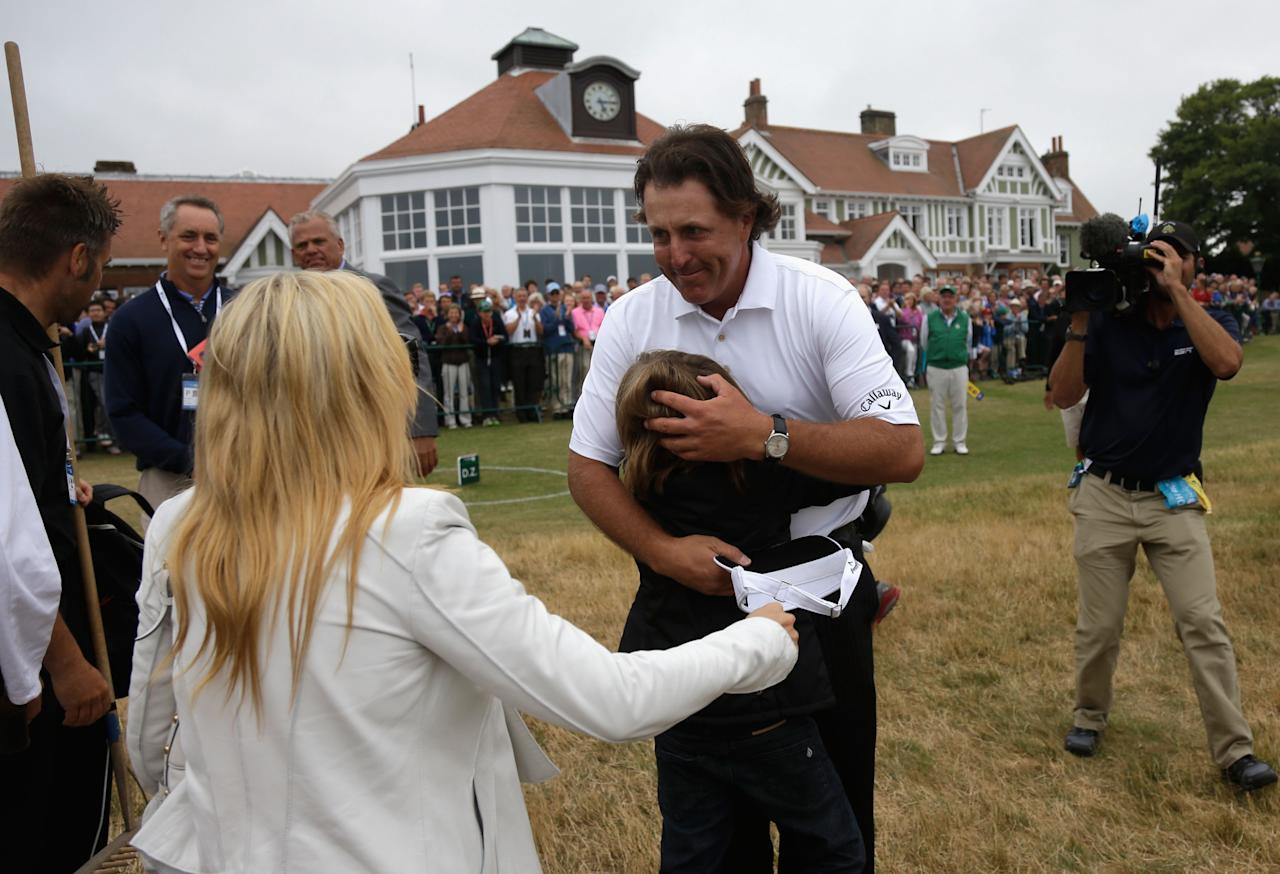 GULLANE, SCOTLAND - JULY 21: Phil Mickelson of the United States hugs one of his children as wife Amy comes over after Mickelson finishes the final round of the 142nd Open Championship at Muirfield on July 21, 2013 in Gullane, Scotland. (Photo by Rob Carr/Getty Images)