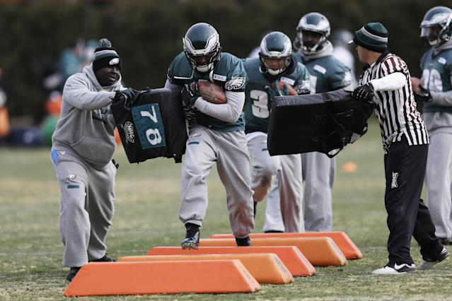 Philadelphia Eagles' LeSean McCoy, center, runs a drill during NFL football practice at the team's training facility, Wednesday, Jan. 1, 2014, in Philadelphia. The Eagles host the New Orleans Saints in a wild-card playoff game on Saturday. (AP Photo/Matt Rourke)