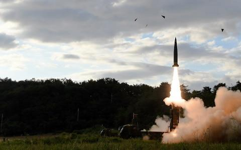 A South Korean Hyunmoo-II missile is fired toward the East Sea in response to the latest North Korean missile test - Credit: EPA