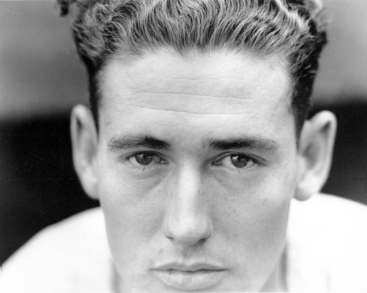 """FILE - This May 23, 1941, file photo shows Ted Williams, outfielder for the Boston Red Sox, at Yankee Stadium in New York City. A new film explores the life of baseball legend Williams who struggled with his Mexican-American heritage and his volatile relationship with his family and the press. The upcoming PBS """"American Masters"""" documentary on the former Boston Red Sox slugger uses rare footage and family interviews to paint a picture of a complicated figure that hid his past but later spoke out and defended black players. (AP Photo/File)"""