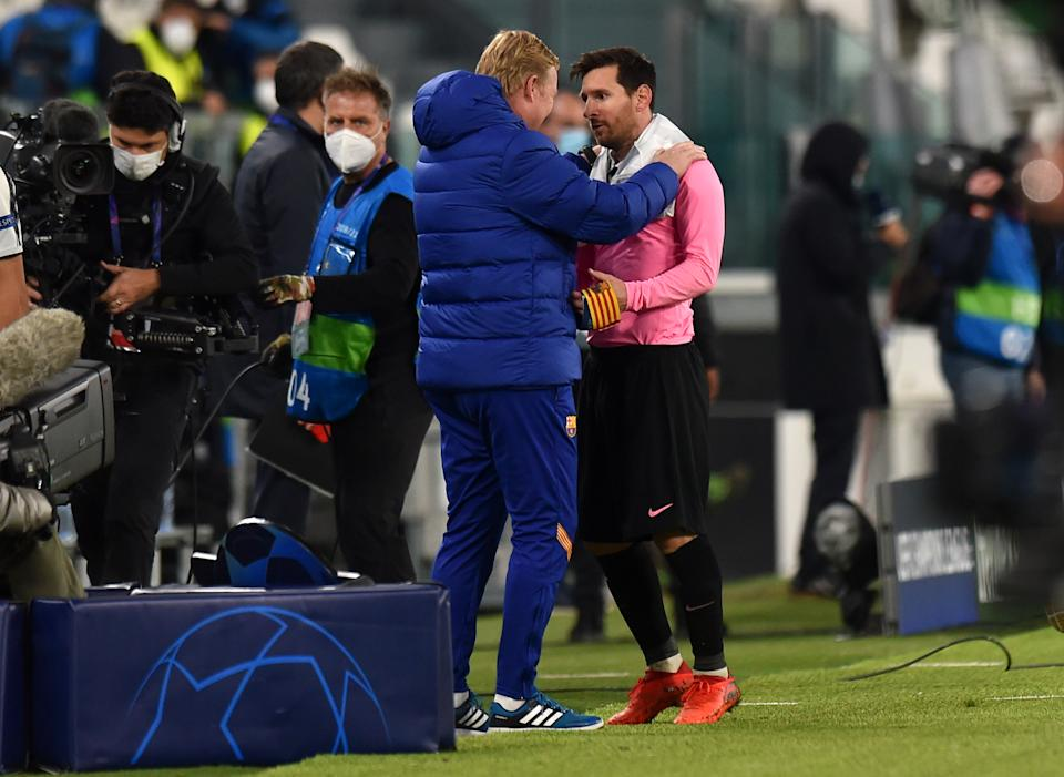 TURIN, ITALY - OCTOBER 28: Ronald Koeman, Head Coach of Barcelona and Lionel Messi of Barcelona speak during the UEFA Champions League Group G stage match between Juventus and FC Barcelona at Juventus Stadium on October 28, 2020 in Turin, Italy. Sporting stadiums around Italy remain under strict restrictions due to the Coronavirus Pandemic as Government social distancing laws prohibit fans inside venues resulting in games being played behind closed doors. (Photo by Tullio Puglia - UEFA/UEFA via Getty Images)