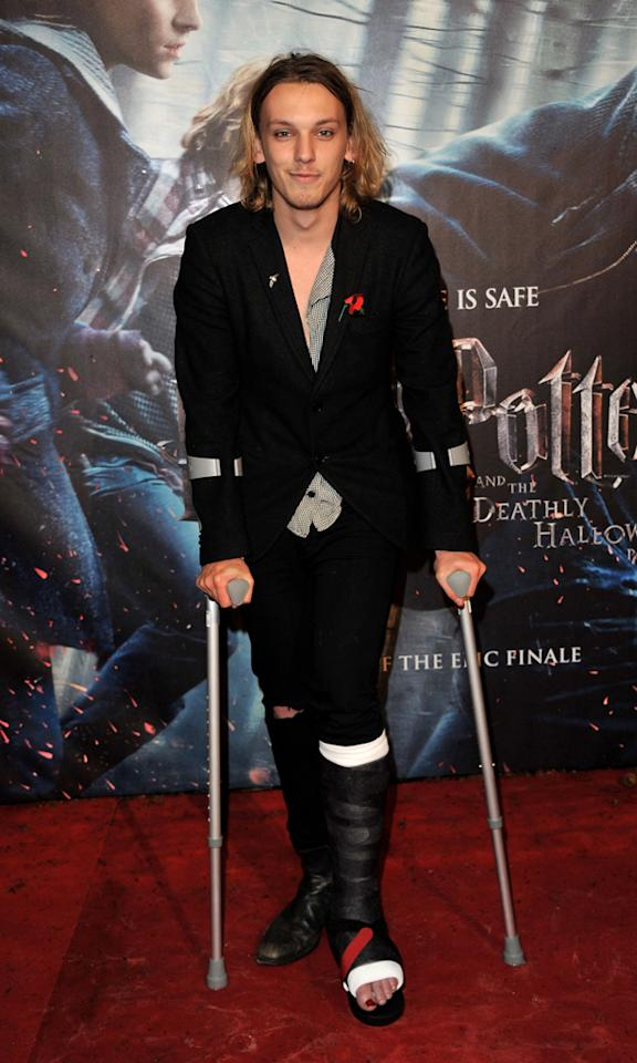 "Bonnie's boyfriend, Jamie Campbell Bower (Gellert Grindelwald), shuffled down the arrivals line with a broken foot, which he injured while filming ""Camelot,"" an upcoming British TV series based on King Arthur."