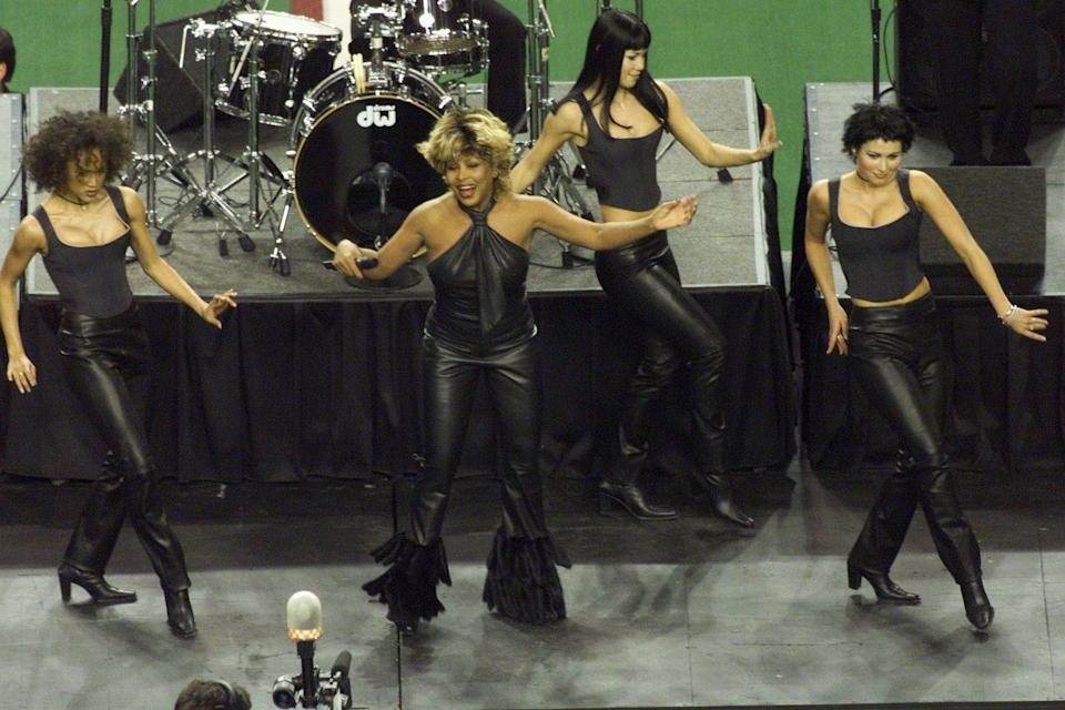 <p>Working a pair of leather pants at the pre-game show for Super Bowl XXXIV in Atlanta. </p>