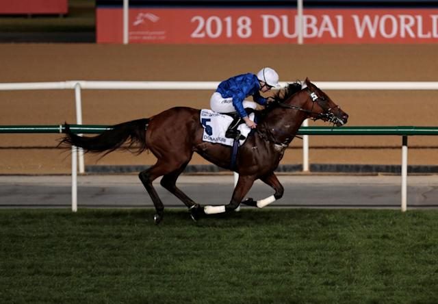 Horse Racing - Dubai World Cup 2018 - Meydan Racecourse, Dubai - United Arab Emirates - March 31, 2018 - Oisin Murphy rides Benbatl from Britain to the finish line to win the Seventh Race. REUTERS/Christopher Pike