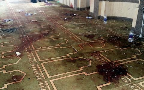 Bloodstained floors at the mosque - Credit: REUTERS/Mohamed Soliman