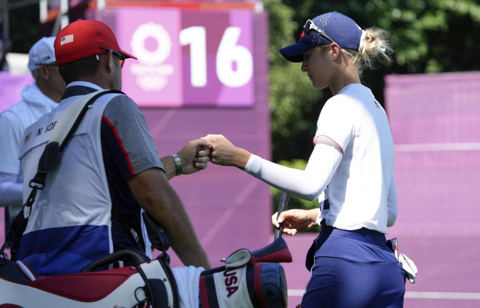 Nelly Korda, of the United States, celebrates after a birdie with her caddie on the 16th hole during the second round of the women's golf event at the 2020 Summer Olympics, Thursday, Aug. 5, 2021, at the Kasumigaseki Country Club in Kawagoe, Japan. (AP Photo/Andy Wong)