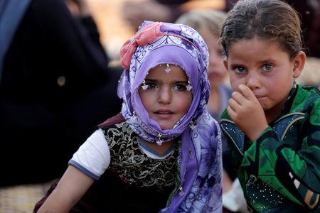 FILE PHOTO: Newly displaced Syrian children react after arriving in a refugee camp in Atimah village, Idlib province, Syria September 11, 2018. REUTERS/ Khalil Ashawi/File Photo