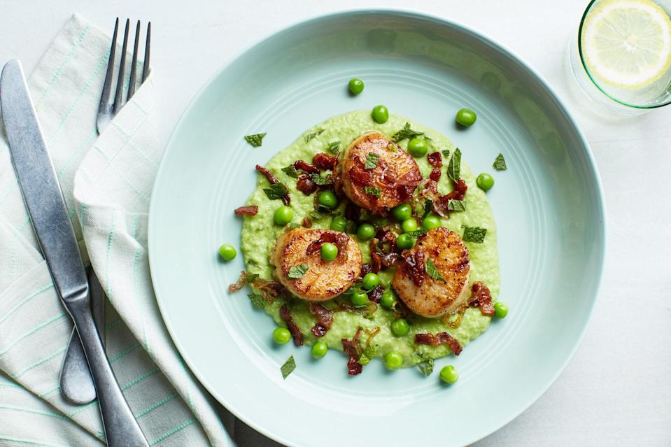 """Bacon and scallops are a classic pairing; here they rest on a bed of sprightly spring green pea purée for a dinner that seems a little bit fancy, but only takes 22 minutes to throw together. <a href=""""https://www.epicurious.com/recipes/food/views/seared-scallops-with-mint-peas-and-bacon?mbid=synd_yahoo_rss"""" rel=""""nofollow noopener"""" target=""""_blank"""" data-ylk=""""slk:See recipe."""" class=""""link rapid-noclick-resp"""">See recipe.</a>"""