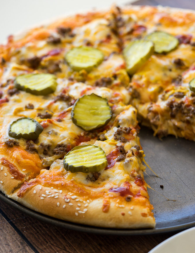 "<p>There's even some special sauce hidden beneath all those toppings. (Spoiler alert: It's fry sauce, aka ketchup, mayo and hot sauce.) </p><p><em><a href=""http://www.iwashyoudry.com/2017/02/01/cheeseburger-pizza/"" rel=""nofollow noopener"" target=""_blank"" data-ylk=""slk:Get the recipe from I Wash You Dry »"" class=""link rapid-noclick-resp""><span class=""redactor-invisible-space"">Get the recipe from I Wash You Dry »</span></a></em><br></p>"