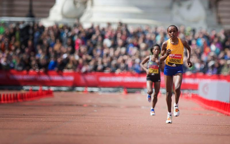Daily Telegraph warren allott for the Telegraph The WINNER OF THE WOMANS ELITE RACE SUMgONG runs along the Mall towards the FINISH LINE in the London Marathon ON April 24, 2016 in London, England - Credit: Warren Allott/Telegraph