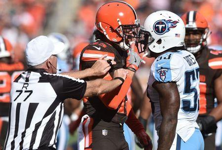 Oct 22, 2017; Cleveland, OH, USA; Cleveland Browns defensive back Kai Nacua (43) and Tennessee Titans linebacker Daren Bates (53) are separated by referee Terry McAulay (77) during the second half at FirstEnergy Stadium. Mandatory Credit: Ken Blaze-USA TODAY Sports