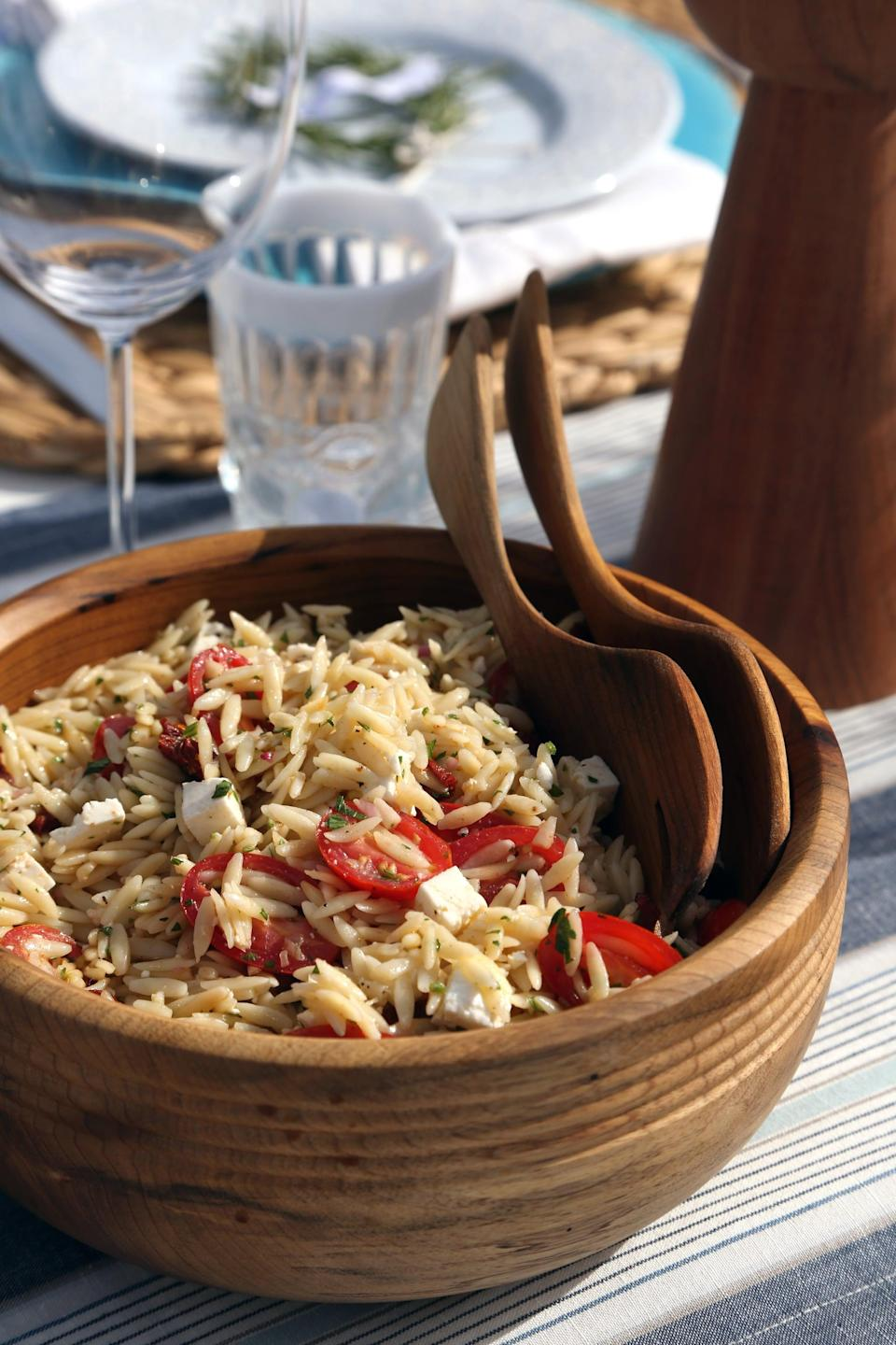 """<p>No, that's not rice - it's orzo, an Italian pasta that resembles rice. It cooks up quickly and absorbs vinaigrette and sauce while keeping its shape like no other, making it ideal for outdoor parties and picnics. This recipe calls for a variety of Mediterranean-influenced ingredients like fresh and sun-dried tomatoes, feta cheese, and olives. Take one bite, and it's almost like you're vacationing on a Grecian isle. Almost.</p> <p><strong>Get the recipe:</strong> <a href=""""https://www.popsugar.com/food/Orzo-Pasta-Salad-Recipe-3470084"""" class=""""link rapid-noclick-resp"""" rel=""""nofollow noopener"""" target=""""_blank"""" data-ylk=""""slk:Mediterranean orzo pasta salad"""">Mediterranean orzo pasta salad</a></p>"""