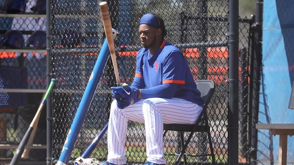 Mets prospect Khalil Lee sitting and holding bat during 2021 spring training