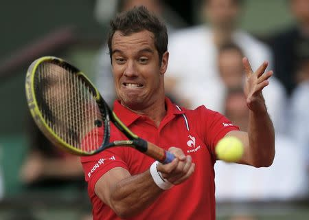 Richard Gasquet of France returns a forehand to Fernando Verdasco of Spain during their men's singles match at the French Open tennis tournament at the Roland Garros stadium in Paris