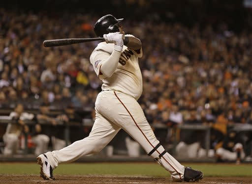 San Francisco Giants' Pablo Sandoval hits a sacrifice fly to deep center field in the seventh inning to tie their baseball game against the New York Mets Tuesday, July 9, 2013, in San Francisco. (AP Photo/Eric Risberg)