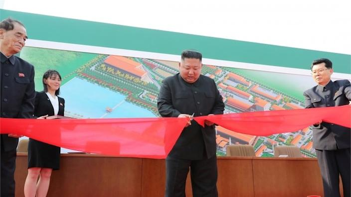 State media issued this picture said to show Kim Jong-un opening the fertiliser plant on Friday
