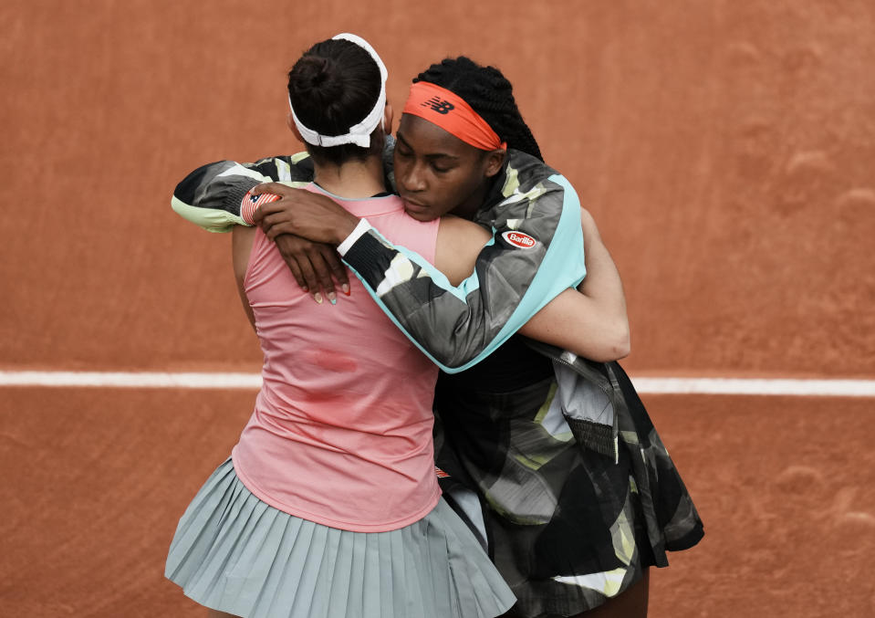 United States's Coco Gauff, right, hugs and commiserates with United States's Jennifer Brady who retired due to injury during their third round match on day 7, of the French Open tennis tournament at Roland Garros in Paris, France, Saturday, June 5, 2021. (AP Photo/Thibault Camus)